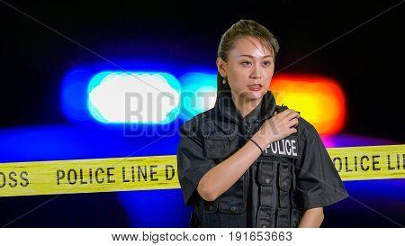 Asian American Policewoman Using Police Radio
