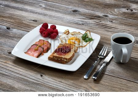 Front view of a morning breakfast meal on old wooden table