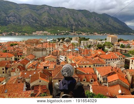 Admiring Orange Color Tiled Roof of Kotor Old City and Kotor Bay from Fortification of Kotor, Montenegro