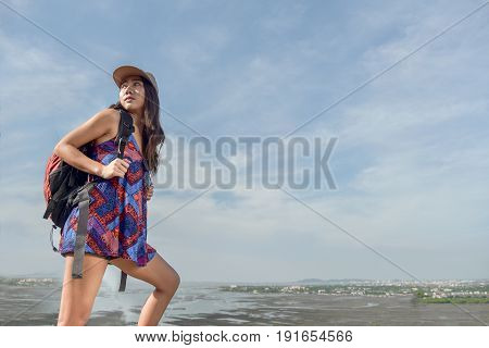 Happy backpacking girl tourist on travel adventure. Young hiking Asian backpacker woman hiker