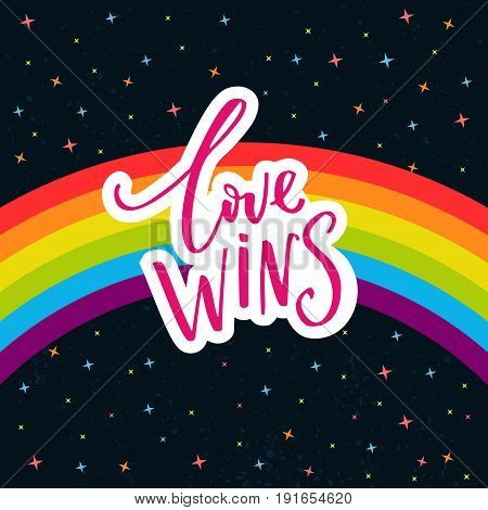 Love wins. Words on rainbow parade flag at dark sky with stars. Gay pride saying for stickers, t-shirts and posters