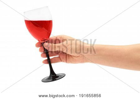 Female Hand Holds Red Wine In Glass. Isolated On White Background
