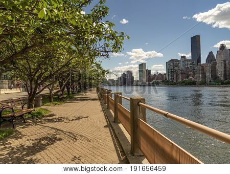 East River and East Side Manhattan Skyline from Roosevelt Island Walkway