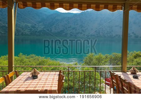 View on the lake Kournas through tavern, Crete