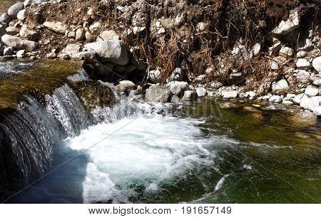 Stormy stream of water mountain river in Bansko, Bulgaria