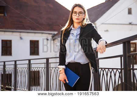 A young lady in a suit before the first in the life job interview