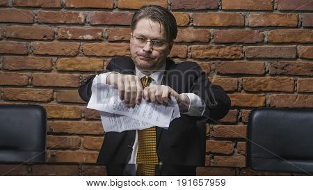 Slow motion of businessman tearing a contract in pieces