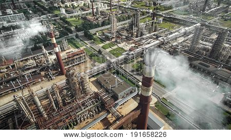Aerial view of oil refinery plant with smokestacks and tanks