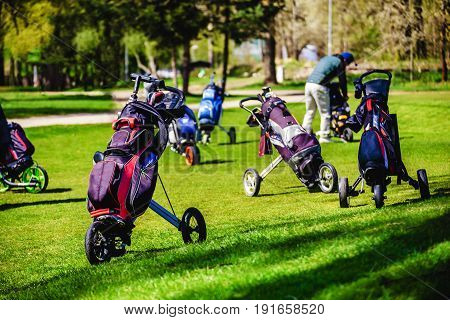 Golf Bags, Golf Clubs In Golf Bag On The Fairway