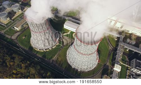 Aerial view of cooling towers with steam