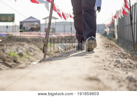 Engineer shoes safety walk in construction site
