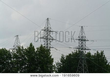 electricity network against a background of dark rainy sky.
