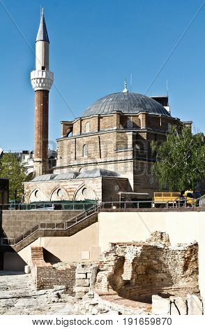 Sofia, Bulgaria - April 10, 2017: Banya Bashi Mosque and ruins of ancient Serdica, Sofia, Bulgaria.The mosque was built around 1567. In any case, the mosque remains an impressive monument of Ottoman architecture and a recognizable landmark of Sofia.