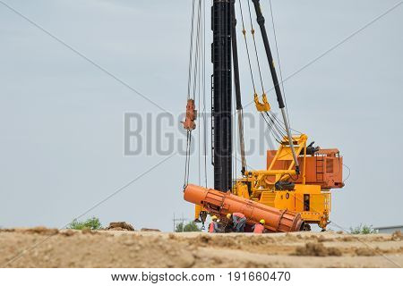 Pile driving machine in the construction site