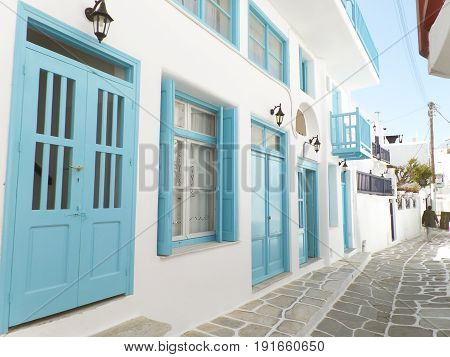 Charming small alley with white and blue colored buildings, Mykonos town on Mykonos island, Greece
