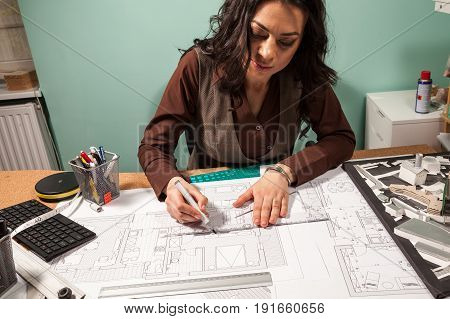 Close up of architect hands working on blueprints. Design and pan. Professional drawing of architect plans