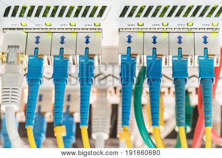 Internet gateway with connected cables and blurred background