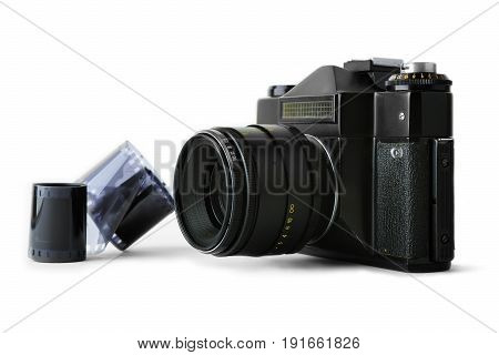 Close-up view of a classic manual SLR camera with film on white background