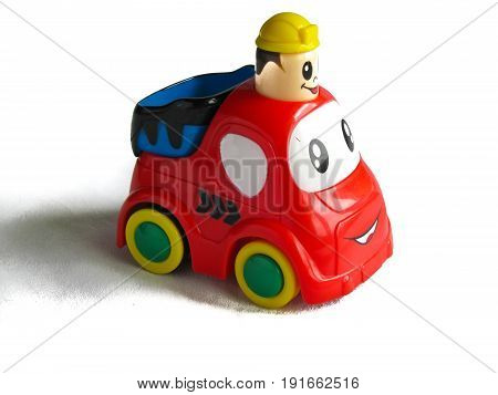 a small toy car isolated on white background with shadow