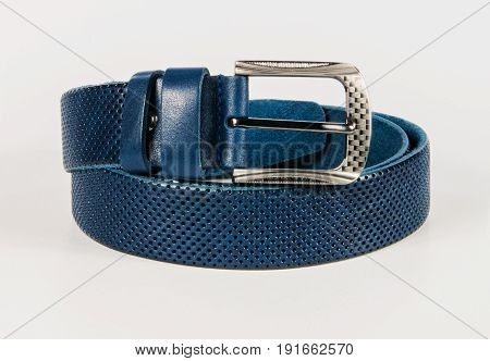 Blue leather belt. White isolated background. Accessories.
