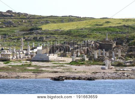 Archaeological Site of Delos as seen from the ferry, UNESCO World Heritage Site on Delos Island of Greece
