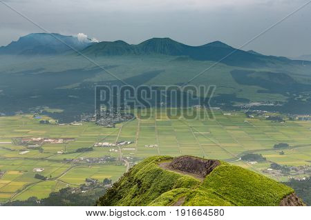 Aso Volcano Mountain And Farmer Village From Hill Top In Kumamoto, Japan