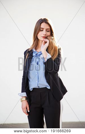 Beautiful woman portrait with long healthy hair. Fashionable women's look with black jacket and blue blouse. Fashion concept