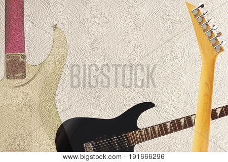 Black electric rock guitar back of guitar body and neck on the light skin background with plenty of copy space.