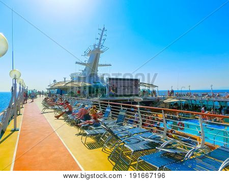 Kusadasi, Turkey - June 10, 2015: The people resting at cruise ship Splendour of the Seas by Royal Caribbean International