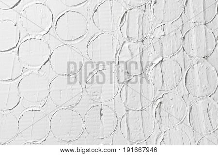 White relief pattern, creative design, stucco structure. Wet plaster building background with free space for text.
