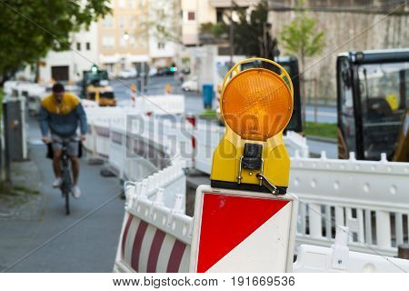 Orange Construction Street Barrier Light On Barricade. Road Construction On The Streets Of European