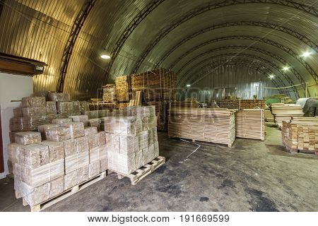 Warehouse Packed With Variety Of Timber For Construction And Repair. Wood Timber Construction Materi