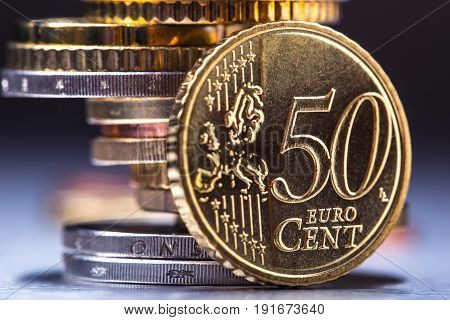 Fifty cent coin on the edge. Euro money. Euro currency. Euro coins stacked on each other in different positions.