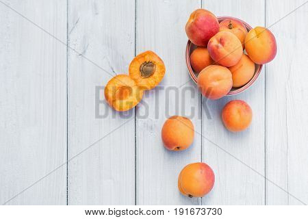Composition with apricots on a white table