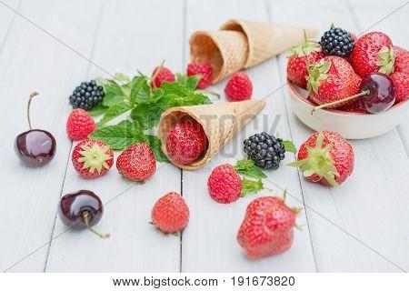 Composition with strawberries cherries raspberries and blackberries
