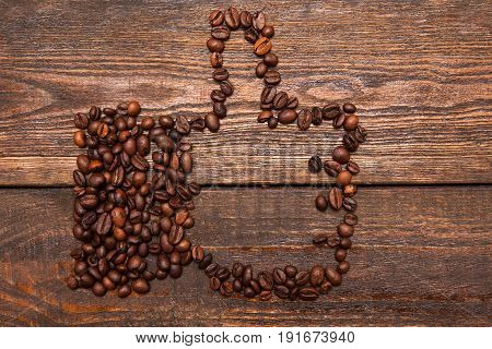 Like gesture made from coffee beans. Love for coffee, high quality, endorsement, social networks concept