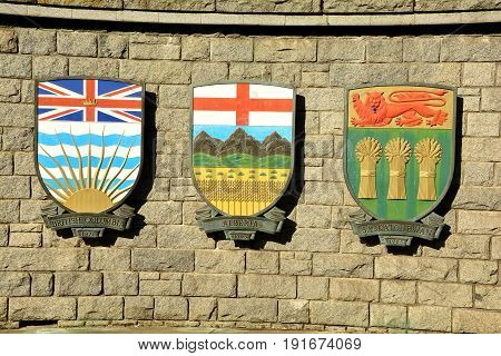 Victoria BC,Canada,August 9th 2014.Coats of arms for the Canadian provinces of British Columbia,Alberta,Saskatchewan, hang on a wall in Victoria