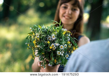 Surprise for girl gift flowers young surprised girl in the park