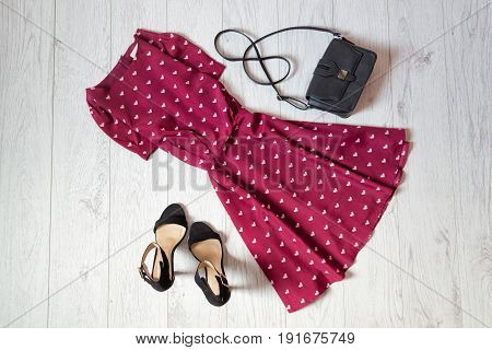 Sundress Burgundy, Black Handbag And Shoes On A Wooden Background. Fashionable Concept