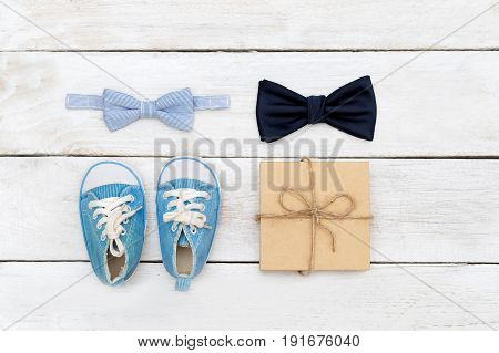 Father and son bow tie; Big and small bow tie on a white wooden background