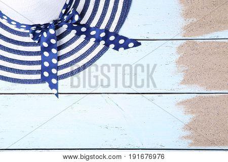 Blue Beach Hat On White Wooden Background
