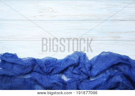 Blue gauze fabric on white wooden table