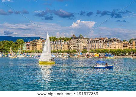 Historic City Center Of Geneva With Boats On Lake Geneva In Summer, Switzerland