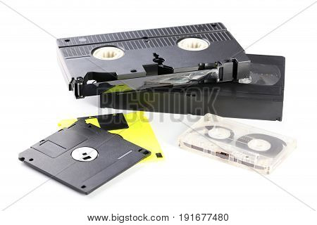 Video And Music Cassette Tapes With Floppy Disk Isolated On White Background