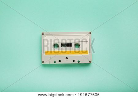 White cassette tape on the mint background