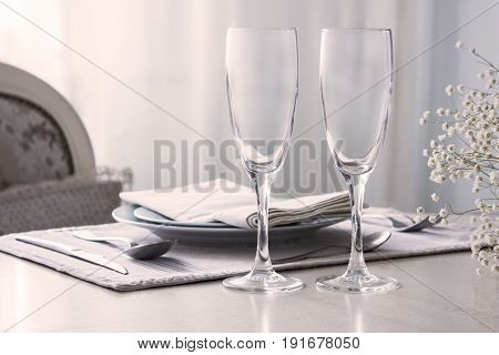 Pair of wine glasses champagne flutes on the wedding table Mockup.