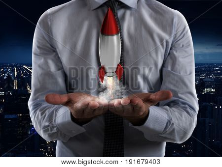 Businessman holding a small rocket. Startup of a new company concept
