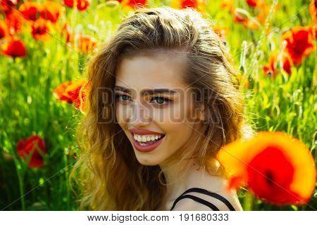 Girl In Field Of Poppy Seed