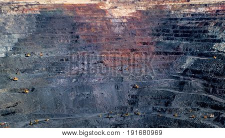Processes of extraction of iron ore in mine. Photo of iron ore quarry