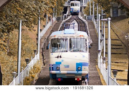 Funicular railway tram lift tunnel on a background of yellow leaves
